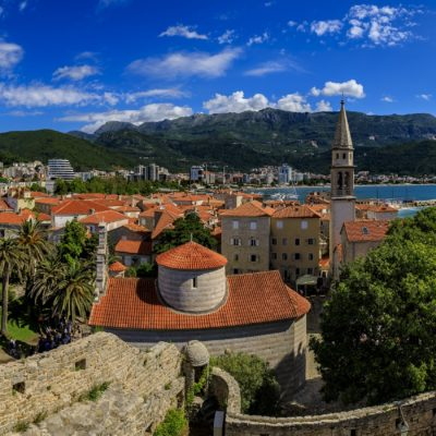 Budva Old Town from the Citadel with the Holy Trinity church and Adriatic Sea in the background in Montenegro, Balkans