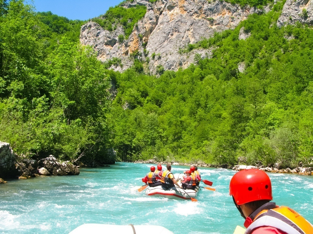 rafting boat on the fast mountain river